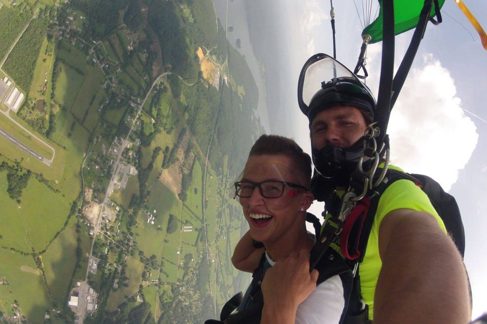 Male skydiver under canopy with Chattanooga Skydiving Company tandem instructor