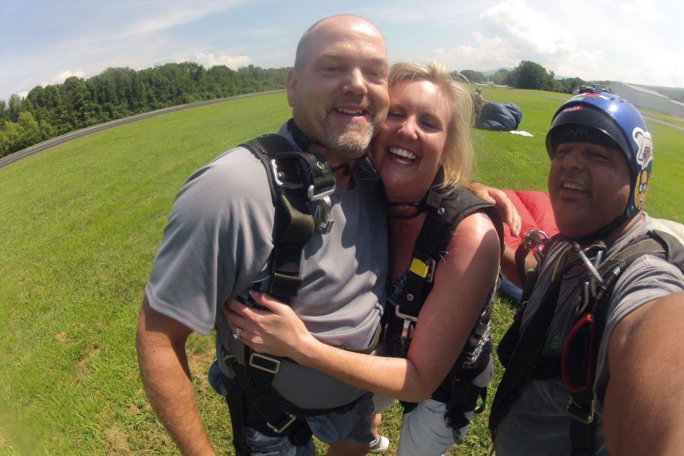 Couple hugging one another after an awesome skydive at Chattanooga Skydiving Company