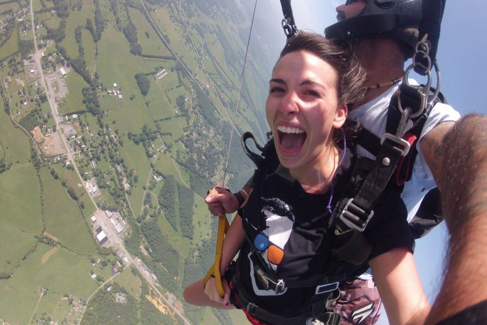 Women smiling with glee while under canopy with Chattanooga Skydiving Company's tandem instructor