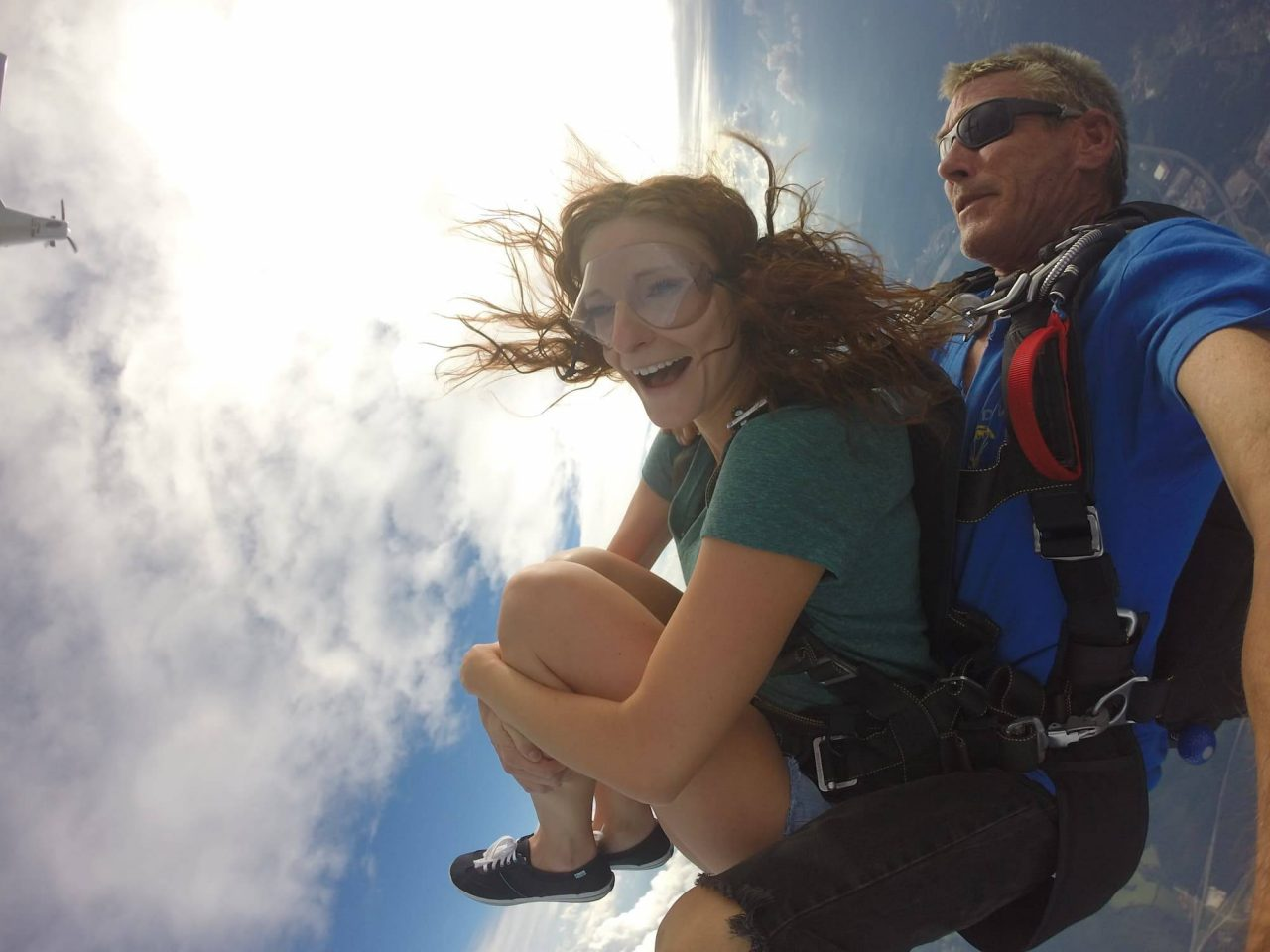 Women in green shirt takes the leap out of the Chattanooga Skydiving Company airplane