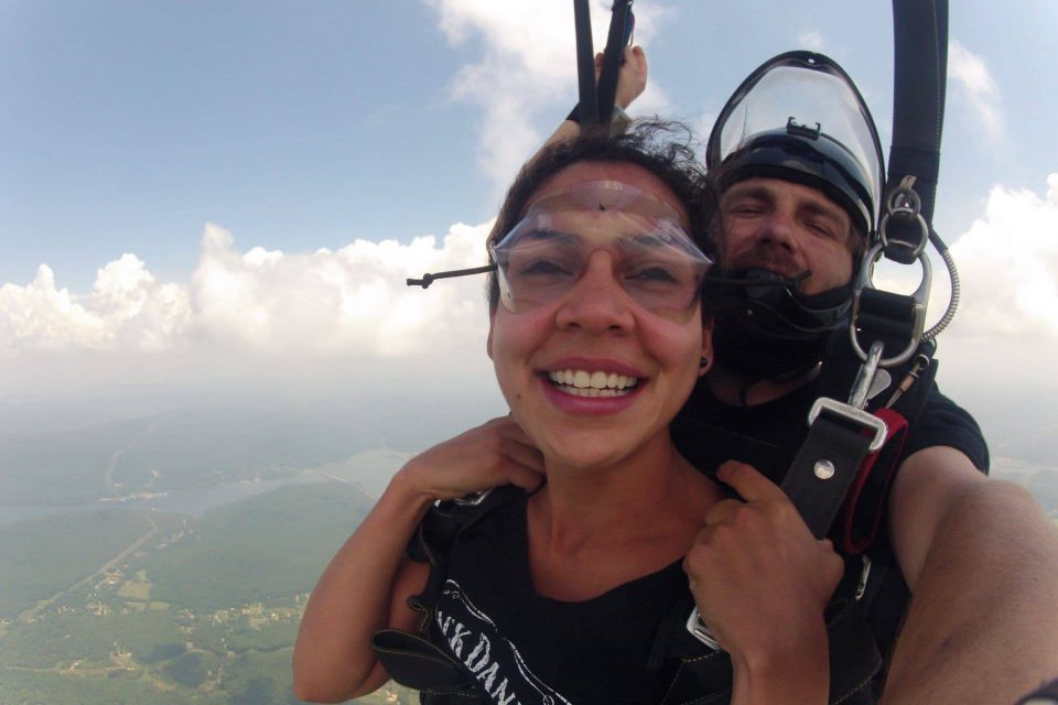 Women smiling during the canopy ride portion of her skydive at Chattanooga Skydiving Company