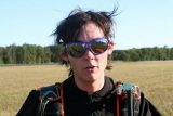Paul Silvia wearing skydiving gear and googles after landing a skydive