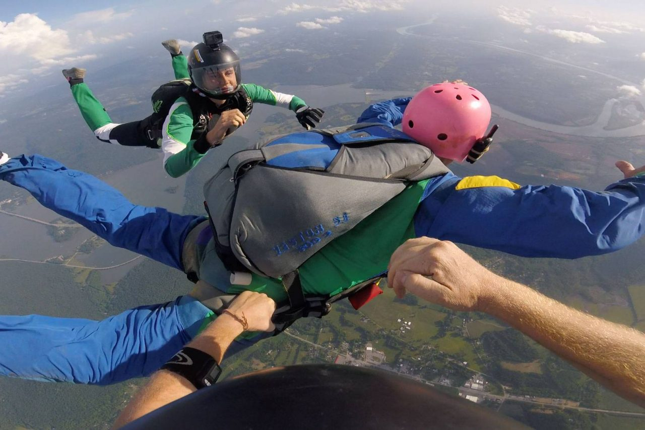 Man wearing pink helmet in freefall during AFF training at Chattanooga Skydiving Company