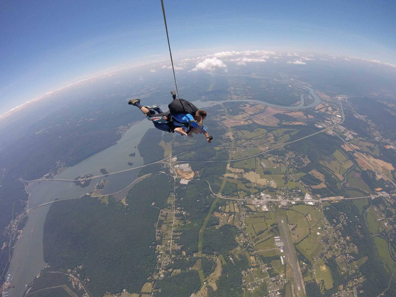 Male tandem skydiver stretches arms out while enjoying his skydive at Chattanooga Skydiving Company