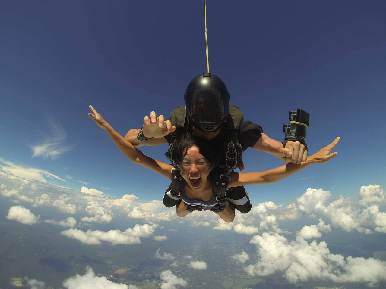 Female holds her arms out in excitement during free fall