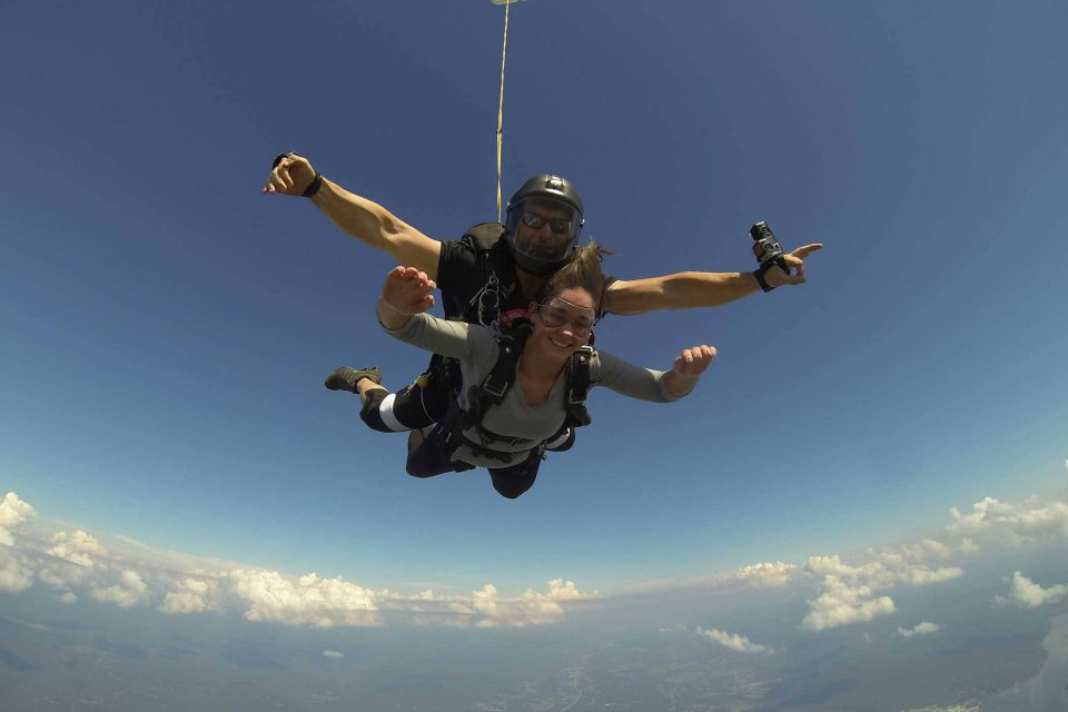 Women holding her arms out during her skydive at Chattanooga Skydiving Company