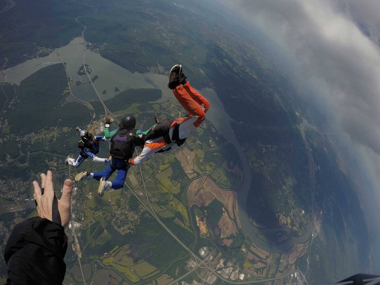 AFF student participating in hands on training while in free fall