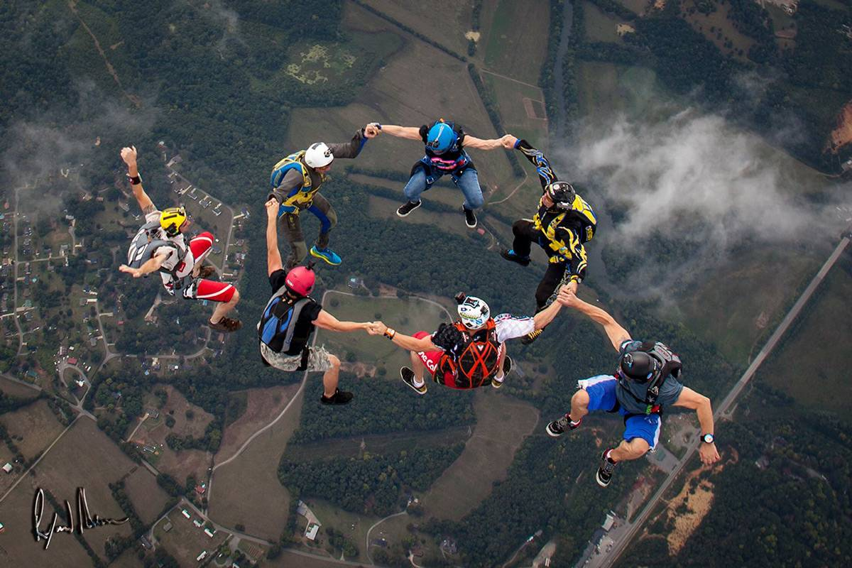 Experienced skydivers in a sit formation during free fall at Chattanooga Skydiving Company